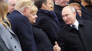 Watch Putins warm thumbs-up to Trump at Paris commemorations