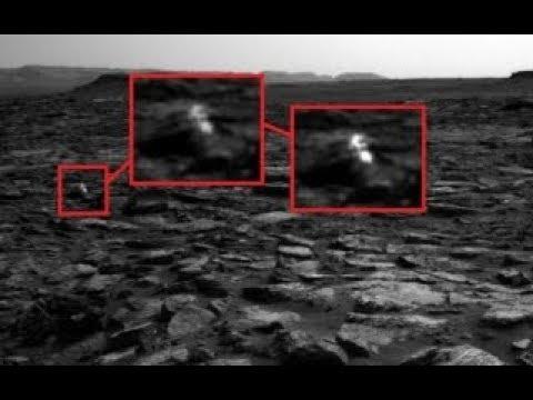 На НОВЫХ снимках с МАРСА обнаружили двух гуманоидов и разбитое НЛО.Тайны красной планеты
