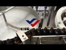 Reliance glass dropper bottle feeding turn table, conveyor system