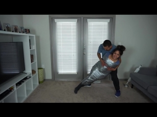 100 LAYERS OF DUCK TAPE CHALLENGE! (PART 2) (HER TURN)