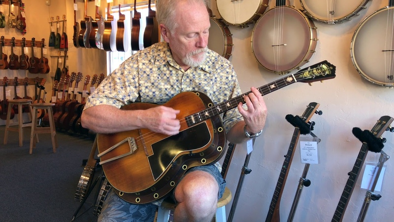 Tom plays a 1933 Paramount Style D Guitar by Martin
