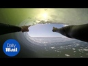 Surfer travels through an epic 8-barrel wave in Africa
