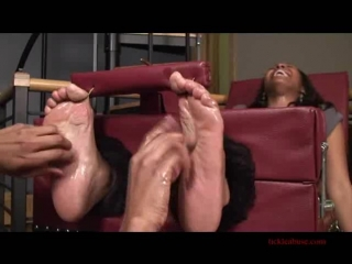 Ebony tickled feet