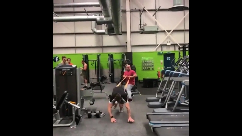 Lad lets go of elastic rope and it smacks into his mates head