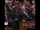 George W. Bush hands Michelle Obama a piece of candy