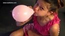 Looner girl blows up balloons and popping them with her nails