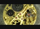 Stock-footage-beautiful-round-clock-mechanism-chain-system-cogs-ruby-jewels-gear-wheels-spin-ultra-high