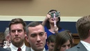 A fast talking auctioneer turned Congressman drowned out this far right protester