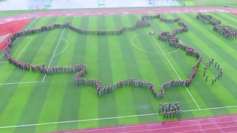 Thousands of college students form a map of China during military training