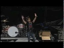 Alex Turner throws his guitar