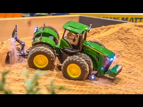 RC tractors, trucks and farming machines at work on a farm! John Deere more!