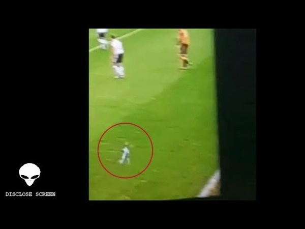 A Smurf sized man jets across the pitch during a live football game... lol (Disclose Screen)