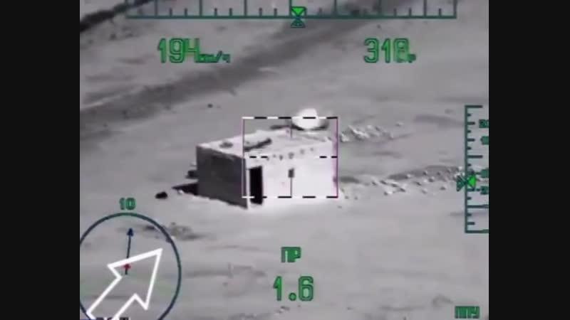 Ми-28Н ведет огонь из пушки.
