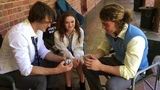 The Kissing Booth's Joey King teaches Jacob Elordi how to solve a Rubik's Cube