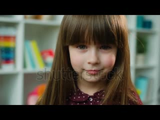Stock-footage-face-portrait-close-up-beautiful-little-girl-looking-at-the-camera