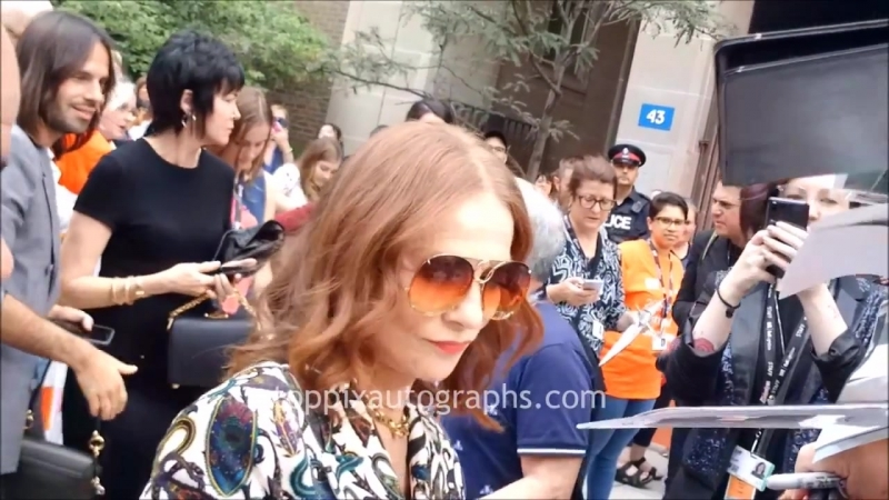 Isabelle Huppert signs autographs for TopPix