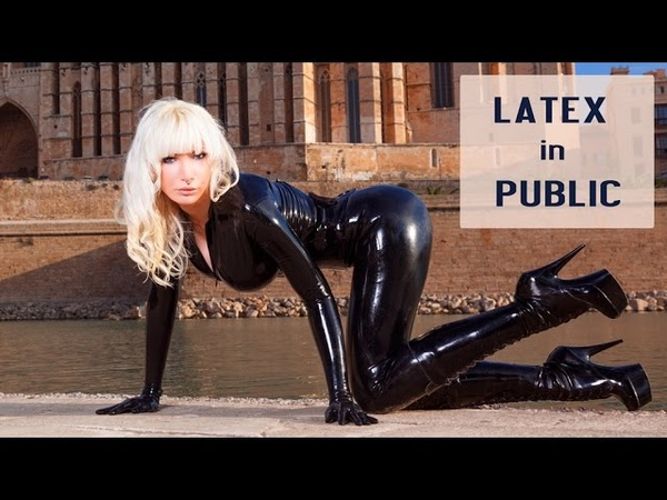 Walking in black LATEX CATSUIT and HIGH HEELS