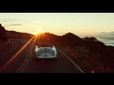 stock-footage-happy-couple-driving-on-country-road-into-the-sunset-in-classic-vintage-sports-car