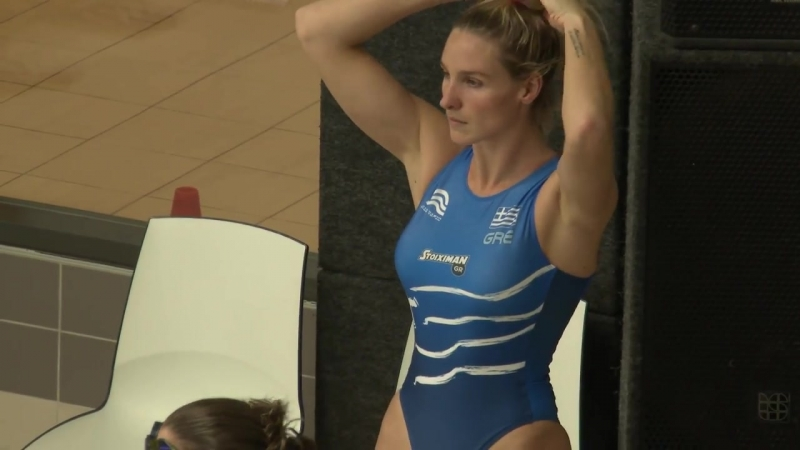 A gorgeous female waterpolo player Greek warmup