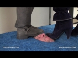 Princess Perfect and friends face trample grey and black boots in box