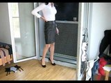 Business lady in leader skirt has a smoke after dressing up