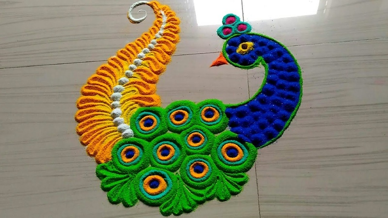 Very easy peacock rangoli for lakshmi pada by jyoti