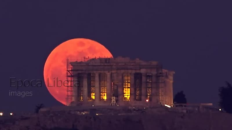Super blue blood moon rises behind the acropolis of athens