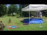 Kid Fails Dive Into Inflatable Pool and Bellyflops on Grass - 997034