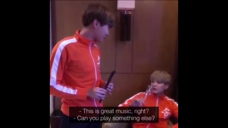 J-hope playing the recorder with his nose