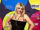 Courtney Love posing for the cameras at the 2006 Blillboard Music Awards