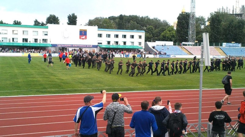 Police clean the stadium in Cherkasy from
