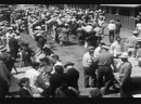 Japanese-American victims arriving at one Exterminating Camp. Notice the machinegun tower at electric fence in background.