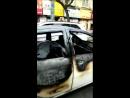 Обгорелая машина едет по улицам