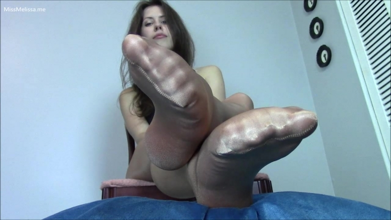 Lady shows her feet in tan shiny pantyhose