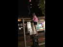 Lad jumping on top of the bus stop falls
