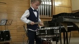 9 years old boy drummer Lyonya Shilovsky plays snare drum like an adult
