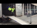 Person doing a flip in to a van whilst working