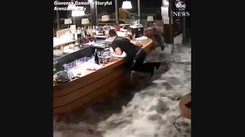 ...Floodwaters crash through windows of restaurant in Italy