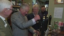 Prince Charles pulls pints and plays darts in Gloucestershire