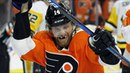 Flyers' Couturier gets five points, three goals on torn MCL