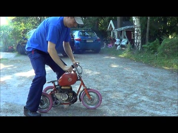 Homemade motorized trike bike with chainsaw engine