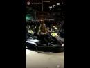 Mariah Carey riding a go kart
