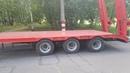 Низкорамный прицеп 9835-73 для перевозки спец техники и оборудования