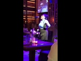 A waitress is sining