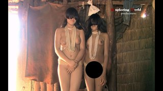 Kalapalo tribe: Alto rio Xingu river. Village of naked indigena. Parque Indígena do Xingu - Brazil