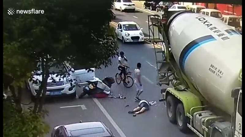 Helmet saves scooter drivers life after she is run over by a cement tanker 2