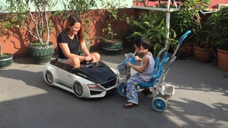 Dylan on a Kiddie Trike Against Mommy Riding a Toy Car
