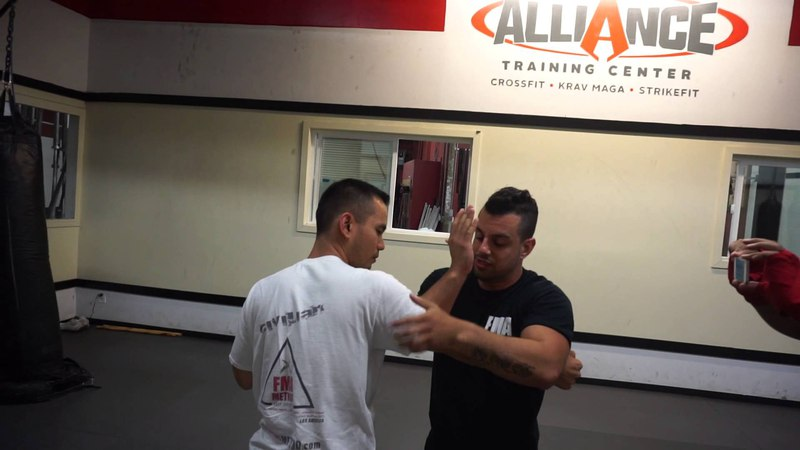 Traditional Silat entrance with takedown and submission