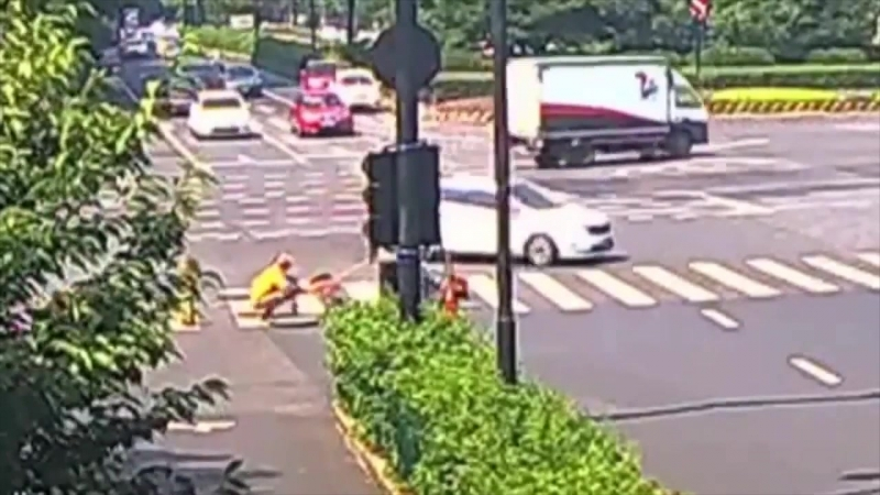 Woman falls into manhole after being hit by car Amazing Clip