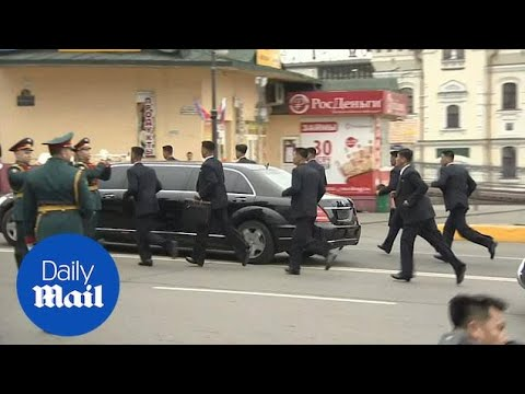 Kim Jong Un arrives in Russia with his running bodyguards